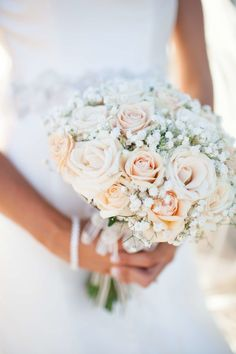 Peach hued roses and baby's breath bouquet: http://www.stylemepretty.com/australia-weddings/2015/07/07/soft-romantic-bouquets-from-across-australia/