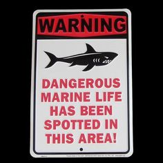 """Shark Tooth Teeth Bite Attack Warning Sign Dangerous Marine Life Beach Plaque by Shark. $11.99. # Hang this Shark Warning Sign above your aquarium to warn visitors about your killer goldfish. # Shark Warning Sign measures 12"""" tall x 8"""" wide with raised lettering. # Marine Life Warning Sign has 2 predrilled holes for easy hanging of the metal sign. # High quality Surfboard Decor Sign is made in the USA from high grade aluminum. # Shark Sign also looks great out on your pool deck..."""