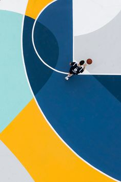 We love this graphic colourful basketball court created by Italian muralist, Gue. Playing here would be so much fun!