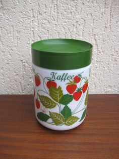 Strawberry Jar, Love these strawberry graphics and the white glass! ~ Mary Wald's Place -  | Container with strawberries | Small container with green lid. Opale. Don't know the company. It says Coffee in different languages.