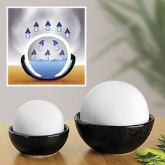 Air Humidifier Rondo - Set of 2 includes 2 humidifier balls which rest in black bowls, which you fill with water. Put an end to the wintry dry spell in your home. The decorative humidifier RONDO ensure a pleasant and healthy room climate. Dry room air irritates the bronchial passages. $29.98 CAD