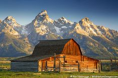 an old barn in front of the Grand Teton Range in Grand Teton Natonal Park