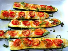 cut a zucchini in half lengthwise & trim a little off the bottom so it will sit still in a baking dish* Scoop out the center where the seeds are* Brush the surface w/ a mixture of crushed garlic, olive oil, salt & pepper* Arrange halved grape tomatoes into the grooves, sprinkle with bread crumbs and bake in a 350 oven for about 30 min* Remove and place diced fontina or mozzarella in between the tomatoes, place them under the broiler til golden/bubbling* remove & drizzle w/ olive oil…
