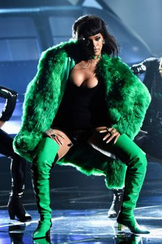 """Rihanna hits the stage looking smokin' to perform her new hit """"Bitch Better Have My Money"""" for the first time live at the 2015 iHeartRadio Music Awards held at the Shrine Auditorium on Sunday (March 29) in Los Angeles. The 27-year-old entertainer started out her performance stepping off of a helicopter on stage surrounded by dancers."""