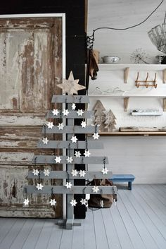 cute advent calendar idea.... love the little wood trees in the back...