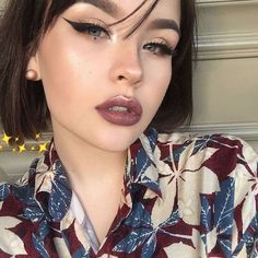 Purple berry lips and simple cat eye: highlight on lips and cheek bones