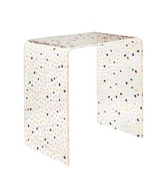 This dotted table will work in just about any room—use it in an entryway to store mail and keys, in a living room to place your magazines and books, or in a nursery to display toys, pictures, and toiletries.