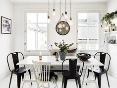 Black and white chairs around the dining table