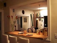 Learn how to remodel your kitchen by transforming a well between the kitchen and dining room into an open breakfast bar.