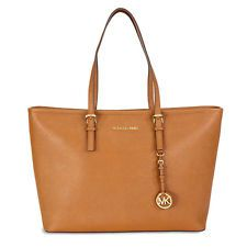 a71d6f673c86 A Michael Kors tote from the Jet Set collection