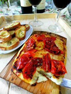 Planked Cheese with Savory Tomatoes