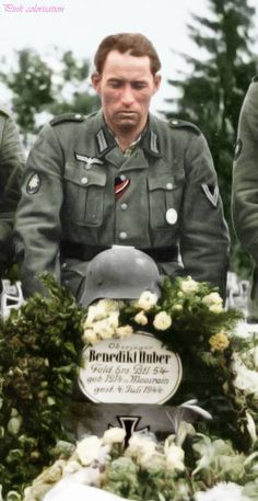 Funeral of a Gebirsjäger in July 1944, Benedikt Huber. The soldier in the middle is wearing a black ribbon in the button hole instead of the black armband.