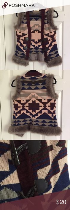 NWOT - Forever 21 one-of-a-kind vest NWT - A colorful vest with tribal patterns that is super cute in the winter months when you're playing in the snow or cozying up in a cabin. Yes, you can still be fashionable in the winter! Tops Sweatshirts & Hoodies