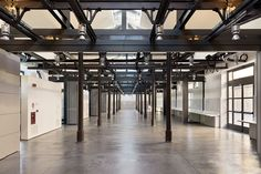 Gallery - Recovery of the former slaughterhouse into University campus / Studio Insula - 9