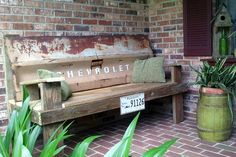 Chevy Chevrolet tailgate bench. Well...one wasp sting, two broke finger nails, three dozen rusty nail pulled from reclaimed lumber, four hours of sweat and labor, I have my husbands Fathers Day gift built. Total cost was about $6 for a box of nails. This girl is give out!!