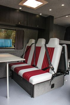 Camper van coversion material store Crash tested Rock n Roll Bed with under bed storage and sliding table.