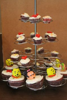 Cupcakes with frsoting topped with 3D fondant characters