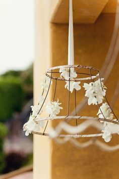bare wire lampshade with flowers, simple and cheap DIY Wire Lampshade, Lampshades, Lampshade Ideas, Light Decorations, Wedding Decorations, Outdoor Decorations, Old Lamp Shades, Sitting In A Tree, Floral Chandelier