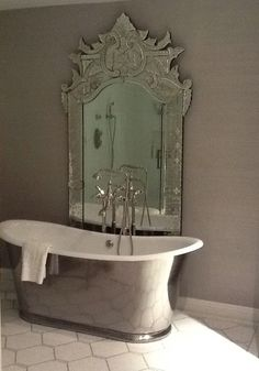 take a moment... Love the tub, and color of walls, and tile floor and mirror. ALL!