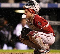 Miguel Montero. Baseball in the snow in Colorado. Blowing a bubble.