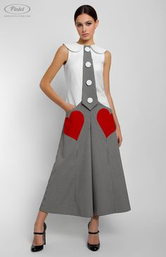 Slim-fit сombined sleeveless stretchy cotton overall with bell-bottom short culottes. Turndown collar. Hidden back zip closure. Side pockets decorated with red hearts. Idle button placket. Unlined.