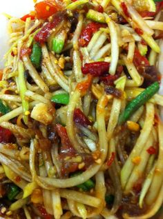 @andrewzimmern Best papaya salad in Midwest at Coco's at Hmong market in MPLs (Coco's is in the food court at the Hmong market in st Paul on Marion and como intersection just north of cathedral)
