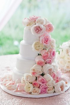 Wedding cake with cascading roses | Photography: Leila Brewster - leilabrewsterphotography.com  Read More: http://www.stylemepretty.com/new-england-weddings/2014/04/28/old-hollywood-glamour-ocean-house-wedding/