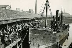 A crowd gathers in anticipation at Aberdeen Harbour in March, 1923 as a trawler is tied up at the quay