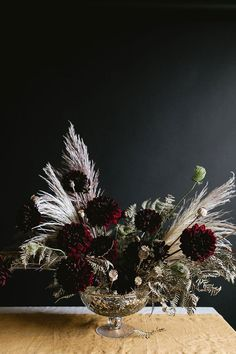 A Dark & Moody Halloween Centerpiece DIY for a grown up or adult dinner party for Halloween or Thanksgiving, made with pampas grass, burgundy dahlias, poppy pods and more. Halloween Flowers, Halloween Decorations, Diy Halloween, Spooky Decor, Halloween 2020, Dark Flowers, Dried Flowers, Floral Centerpieces, Floral Arrangements