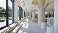 Shanghai Jiading Public Library by Vermillion Zhou Design Group | Tree-like columns + pale (calming) tones