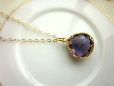 Gold Amethyst Necklace Purple - Pear Shape with Gold Design - Bridesmaid Necklace - Wedding Jewelry Bridesmaid Jewelry  The amethyst gem has a 16k gold plated design around it. The design is identical on the front and back of the gems. The gem measures 13mm by 12mm with 5mm thickness at the wid...