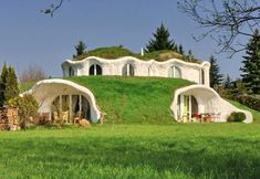 Modern Hobbit houses in Switzerland by Vetsch Architektur
