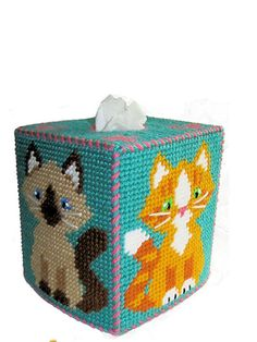 "Popular Siamese, calico, tuxedo and tiger kitties with cute ""paw prints"" on the tissue box top. Stitched on 7-count plastic canvas; topper fits a standard boutique tissue box and coasters are 4"" square."