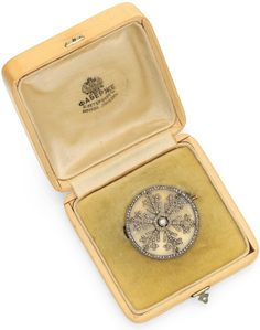 Miniature masterpieces by Fabergé A very rare diamond and rock crystal silver-topped gold-mounted 'snowflake' brooch, by Fabergé, circa 1913. 1⅛ in (2.9 cm) diameter.