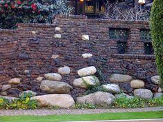 Greene and Greene clinker brick and river stone wall