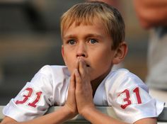 A young WSU fan looks on as Colorado ties the game against WSU during the second half of a PAC 12 football game.