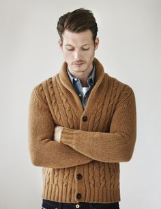 Love the tan, cable-knit, shawl-collared sweater paired with a denim chambray shirt!