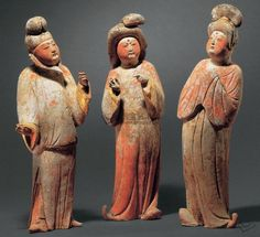 TANG DYNASTY (618-907) A GROUP OF THREE PAINTED POTTERY FAT FIGURES