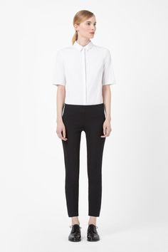 A versatile style, these slim-fit cropped trousers have a metal side-zip fastening. Cut to sit on the waist, they have a single back pocket, comfortable elasticated waistband and a simple clean front. Cropped Trousers, My Wardrobe, Black Pants, Fashion Brand, Cos, Normcore, Street Style, Clothes For Women, My Style