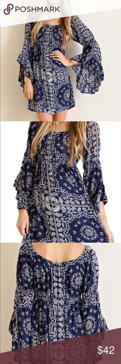 BOHO BELL SLEEVE MINI DRESSPrice drop Very pretty white & navy bell sleeve mini dress. Light elastic under the bust to flatter your figure. Slight swing bottom which makes its lay nicely. Beautiful dress. all retail is firm unless bundled Boutique Dresses Mini
