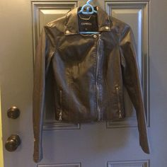 """Vegan friendly Express """"leather"""" moto- NWOT Express (minus the) leather moto jacket in a size extra small. The color is black but it has a slight distressed look to it. It is vegan friendly and new without tags. I took the tags off before realizing it was too small. Make me an offer!! Express Jackets & Coats Utility Jackets"""