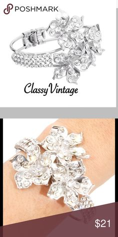 Elegant diamond encrusted floral bracelet Silver tone metal with a spring clasp. 3 beautiful bejeweled flowers and faux diamonds go half way around. Stunning light catching bracelet Sophia Collection  Jewelry Bracelets