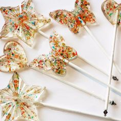 Invite glitz and glamor to the occasion with this set of four lollipops. Adorned with genuine Swarovski crystals, lollipops shine and shimmer with edible sparkles and a pearl back. Create unique place settings at a wedding or New Year's celebration. Individually wrapped, lollipops are butterfly, star or heart shaped and arrive in an elegant box, ready for gift giving. <br> <ul> <li> 4 pieces per order</li> <li> Length: 6 inches </li> <li>...