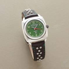 """EVERGREEN WATCH--Our exclusive studded leather quartz watch features a green face that sets off white numerals and red and silver hands in a silverplated brass bezel. Sterling silver beads and green stitching highlight the leather band. Quartz movement. Fits 5-3/4"""" to 7-1/4"""" wrists"""