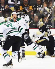Jamie Benn and Alex Goligoski celebrate Tyler Seguin's winning goal in front of Penguins goaltender Marc-Andre Fleury in the final seconds of the third period Thursday, Oct. 16, 2014, at Consol Energy Center.