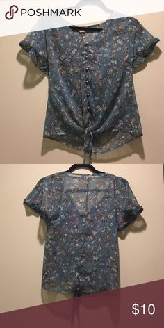 Sheer blue floral top Sheer blue floral print top with silver buttons and tie in the front! Mudd Tops Blouses