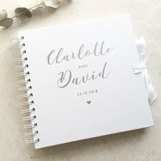 Personalised guestbook in silver and white. By Laura Godbold Design