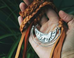 Howling wolf woodland and leather pendant necklace handcrafted by Umber Dove