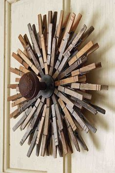 Clothespin Sunburst Wreath by Mamie Jane's.  I think this would look cool painted chrome or gold.