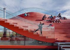 The roof of this bright red tennis clubhouse by Rotterdam firm MVRDV doubles up as an expansive seating area for game spectators